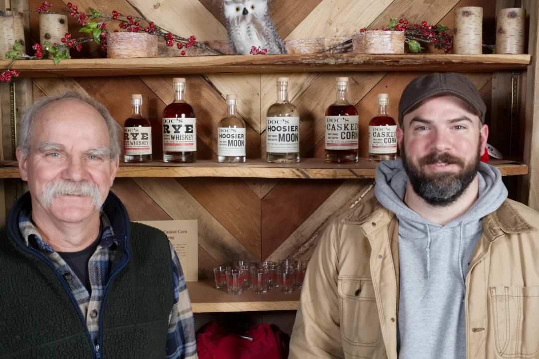 Doc and Jesse with their whiskeys in the gift shop.