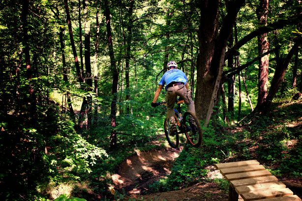 Daniel Goldbach jumps into the chasm at the Harmonie State Park Mountain Bike Trail